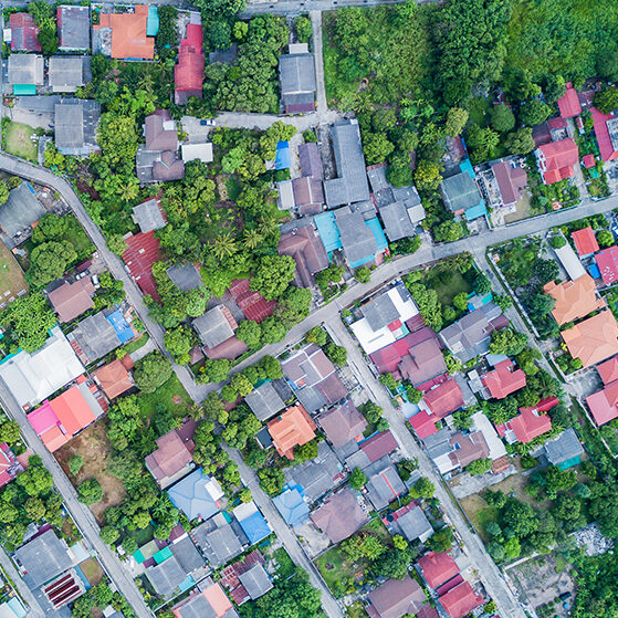 Aerial photo from drone: neighborhood with residential houses and driveways, land use planning concept